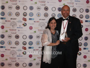Dr. Ansari and his wife after receiving the Pioneer in Medicine Award From the Society for Brain Mapping & Therapeutics